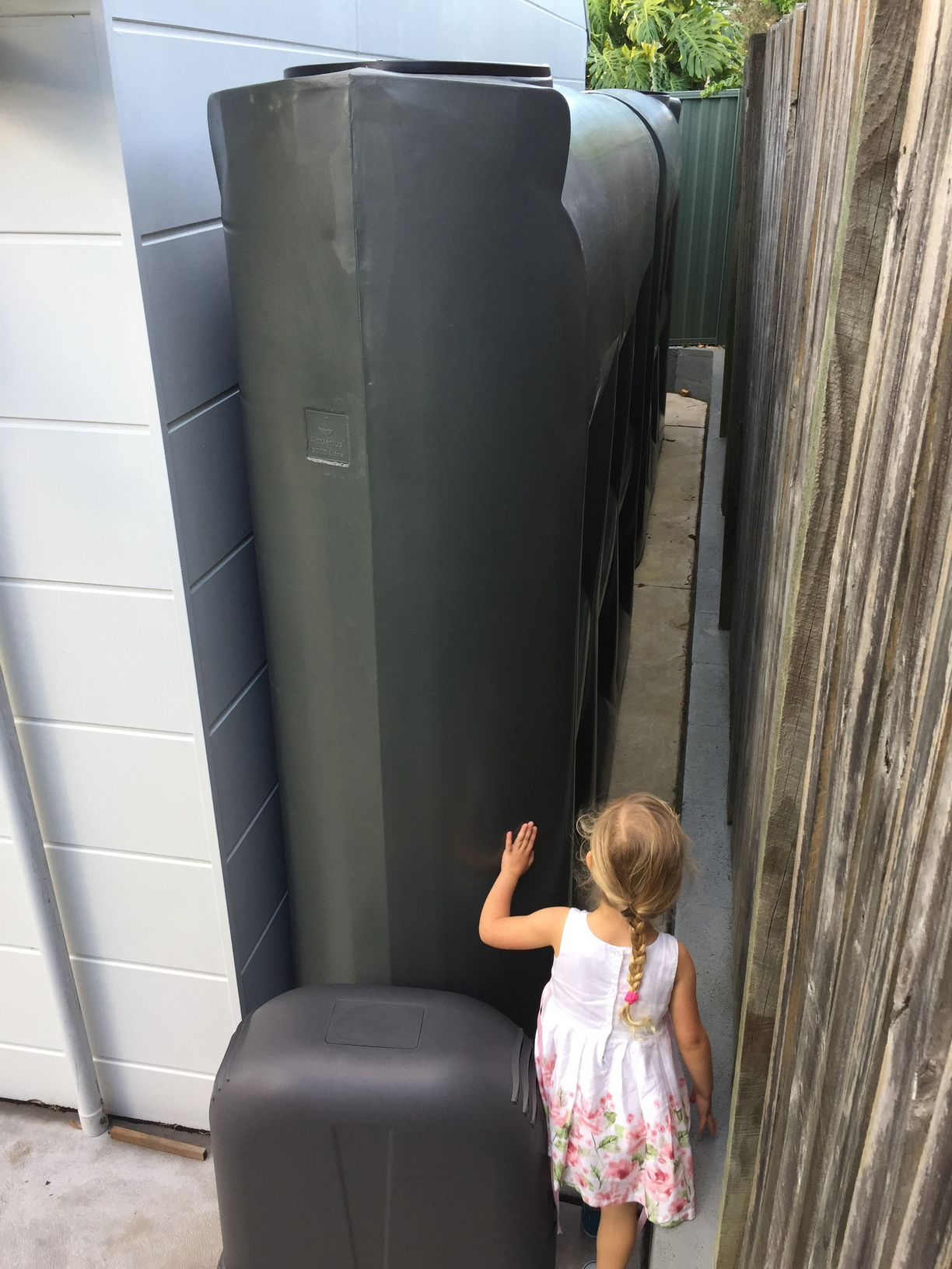 My daughter inspecting the location of the tanks and pump enclosure
