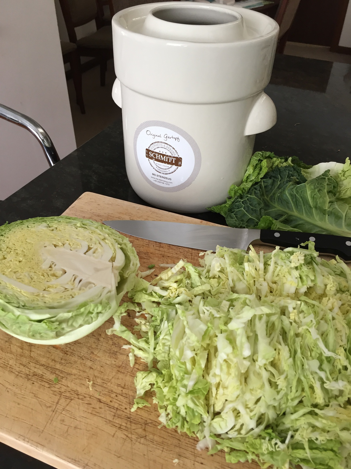 Chopped cabbage and the fermenting crock