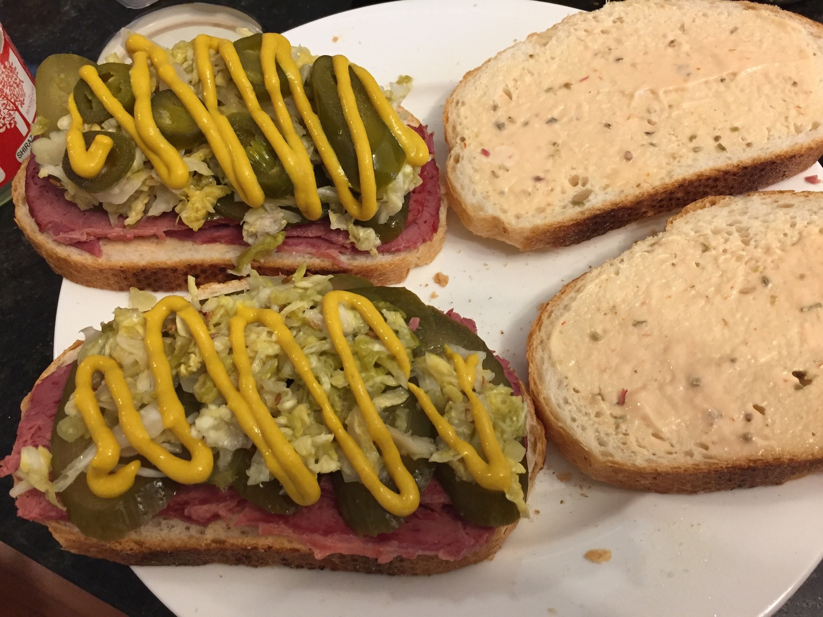 Reuben sandwiches with Russian dressing and American mustard, ready to be toasted. Mine has jalapenos on it because... jalapenos are awesome!